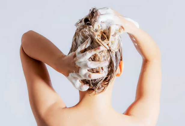woman's shampooing her hair