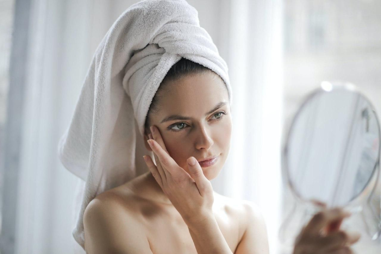 woman takes care of her skin